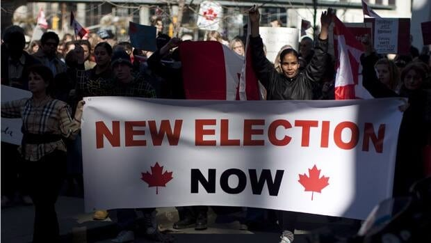 Protesters march during a demonstration in Toronto on Sunday March 11, 2012. A group of voters, backed by the Council of Canadians, wants the court to overturn the results because of allegations of misleading phone calls that attempted to send voters to the wrong polling stations.