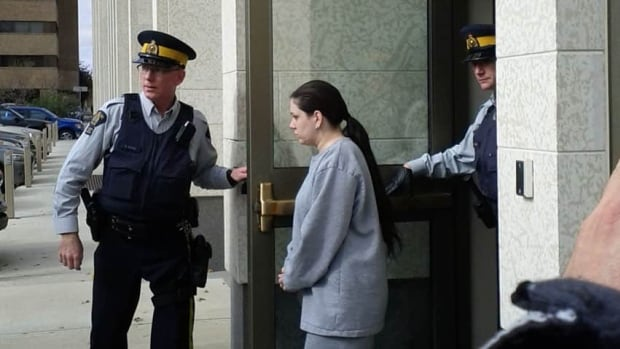 Anna Wilkes is escorted out of court Thursday after being sentenced to eight years in prison.