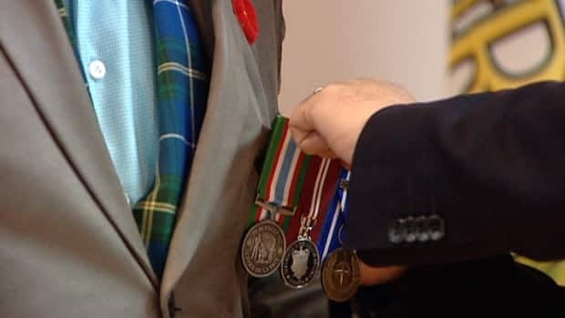 MP Peter Stoffer hosted a ceremony on Friday to re-present Dennis Manuge with his service medals.