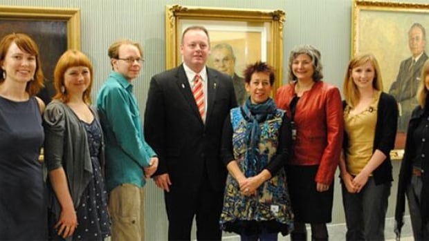 Minister of the Provincial Capital Commission, Kevin Doherty, with the artists chosen for the artist-in-residence program at the Legislative Building.