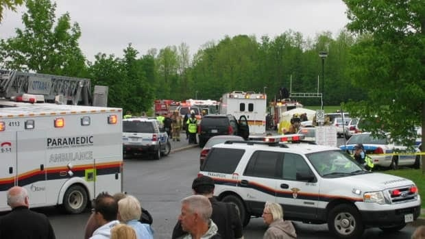 Emergency vehicles, parents and students crowded outside an Ottawa high school after an explosion.