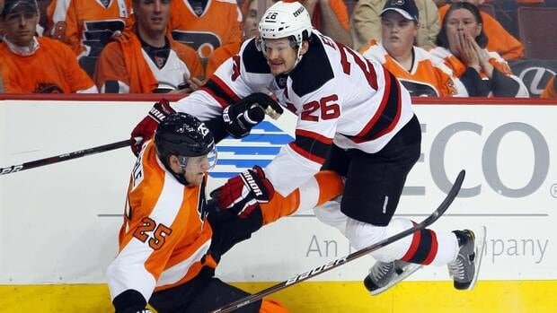 Philadelphia Flyers' Matt Carle is down on the ice after a hit from New Jersey Devils' Cam Janssen during the first period in Game 2 on Tuesday night.