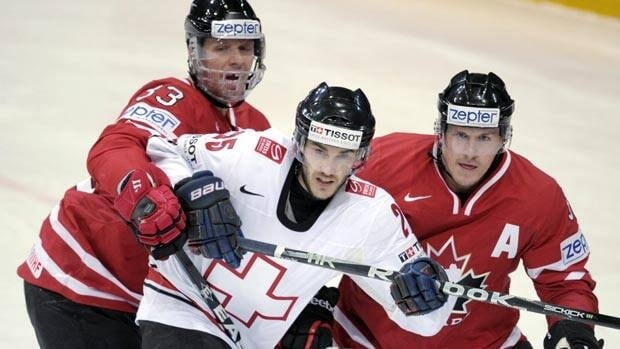 Columbus Blue Jackets defenceman Marc Methot, left, is representing Canada at the worlds for the second time.