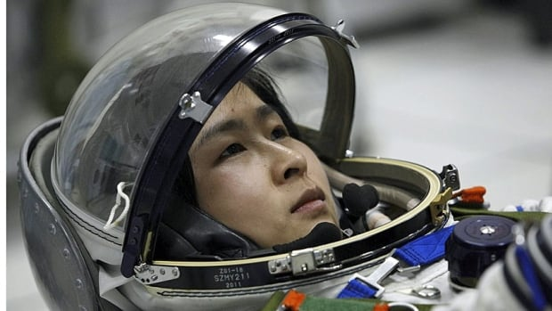 Liu Yang, China's first female astronaut, is photographed during training in Beijing in April. China will send its first woman into space Saturday along with two other astronauts to work on a temporary space station for about a week.