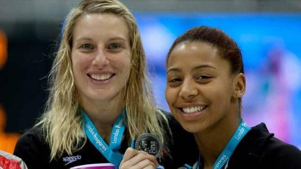 Emilie Heymans, left, and Jennifer Abel scored 321.90 points at the Olympic Aquatic Centre.