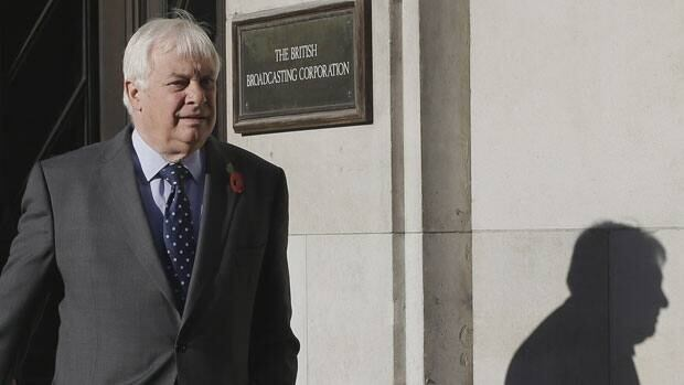 Chris Patten, Chairman of the BBC Trust walks out of the BBC headquarters to give a media interviews in London, Sunday.