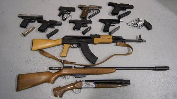 Toronto police say they seized these guns from a home on Huron Street, after a search warrant was executed on Sunday, June 24, 2012.