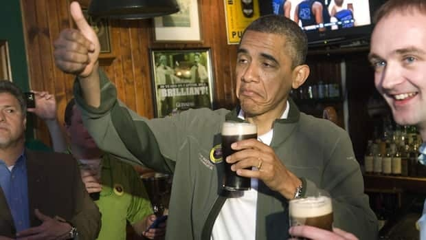 U.S. President Barack Obama, going along with his campaign's wish to be portrayed as a guy with whom people would like to have a beer, celebrates St. Patrick's Day in an Irish pub in Washington, March 17.