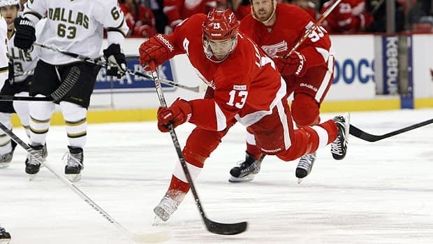 Pavel Datsyuk fires a shot on net for Detroit during Tuesday's record-setting game at Joe Louis Arena.
