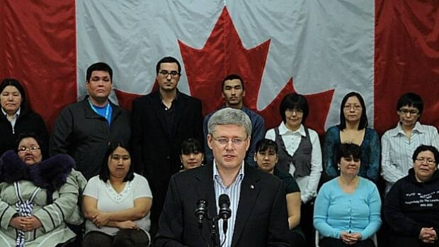 Prime Minister Stephen Harper speaks in front of students at the Nunavut Arctic College in Iqaluit on Thursday. When reporters asked about concerns raised by provincial and territorial governments such as Nunavut's about the budgetary impact of the federal government's recent moves in areas like crime, Harper said his government intends to stick to its campaign promises.