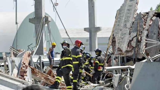 Italian firefighters search the debris of a collapsed factory in Mirandola, northern Italy, Tuesday. A magnitude 5.8 earthquake struck the same area of northern Italy stricken by another fatal tremor on May 20.