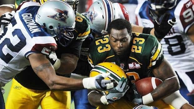 Edmonton Eskimos' Jerome Messam, here separated from his helmet by the Alouettes, is rumoured to be signing with Miami in the NFL after a breakout year.
