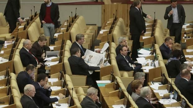 Russian lawmakers attend a session of the lower house of the State Duma in Moscow on Friday. Lawmakers have unanimously voted in favour of a measure that would ban Americans from adopting Russian children.