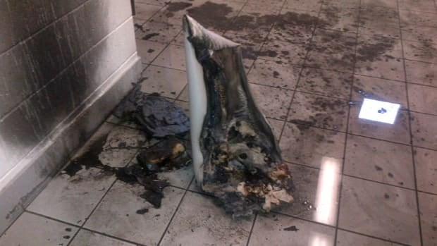 Springhill police say this garbage can was lit on fire in the men's bathroom of the community centre.