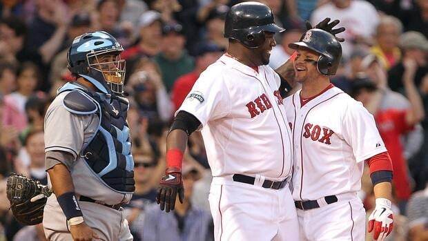 Cody Ross, right, of the Boston Red Sox celebrates his home run with David Ortiz as Jose Molina of the Tampa Bay Rays looks on during Saturday's game.