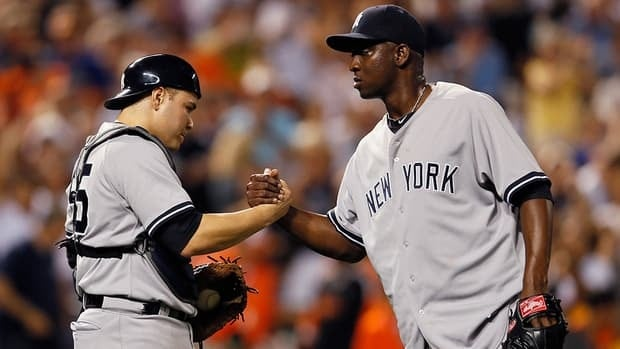 Catcher Russell Martin and closer Rafael Soriano are seen here celebrating after a Yankees victory. With New York trying to get its payroll under the luxury tax threshold, Martin chose to sign in Pittsburgh and Soriano could be the next player to go elsewhere this off-season.