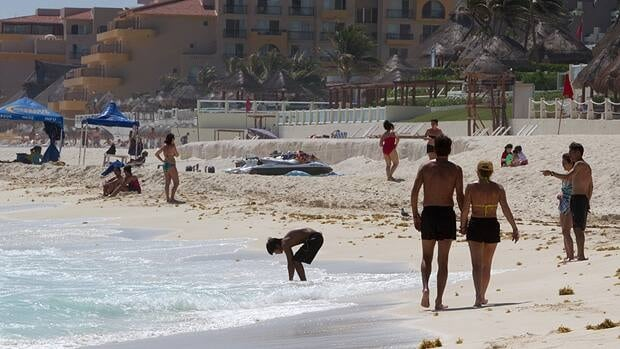 Tourists relax on the beach in Cancun last month. Mexico is a safer destination for Canadian tourists than China and Jamaica, with lower rates of assaults and murders, data compiled from the Department of Foreign Affairs over a decade shows.