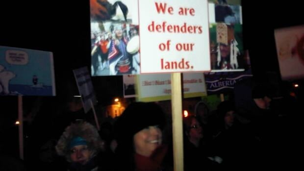 More than 100 people marched in the bitter cold in Prince George, B.C., Wednesday night to protest the Enbridge public hearings on the Northern Gateway pipeline
