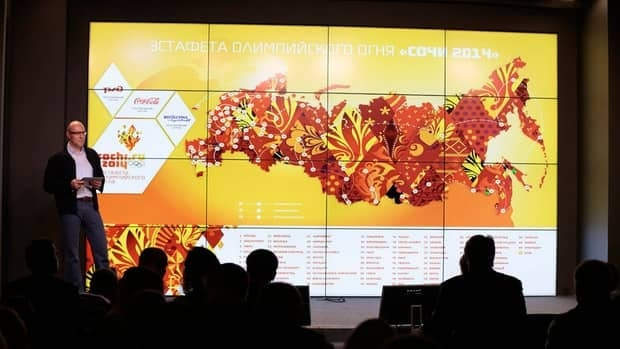 Sochi 2014 Olympic Games organizing committee president Dmitry Chernyshenko, left, presents a map of the Olympic Torch relay, in Moscow, Russia, on Sunday, Oct. 7, 2012.