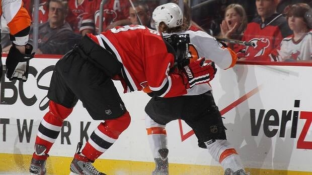 Devils forward Dainius Zubrus, left, is hit by Philadelphia's Claude Giroux in the second period of Game 4 on Sunday night.