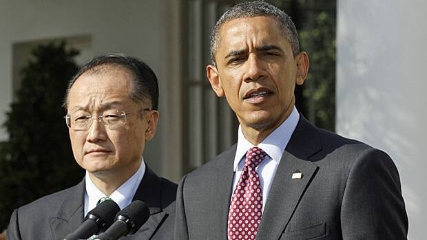 President Barack Obama stands with Jim Yong Kim, his nominee to be the next World Bank President, in the Rose Garden of the White House in Washington, Friday, March 23, 2012. Kim is currently the president of Dartmouth College.