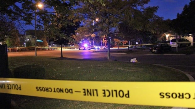 Peel Regional Police cordon off the scene of a shooting near the Credit Valley Hospital in Mississauga early Monday. One man was wounded in the pelvis and rushed inside the hospital, where he remains in stable condition.
