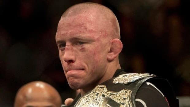 Georges St-Pierre holds the belt after defeating Carlos Condit at UFC 154 on Sunday, November 18, 2012 in Montreal. According to his coach, St-Pierre wants to face Anderson Silva in a superfight.