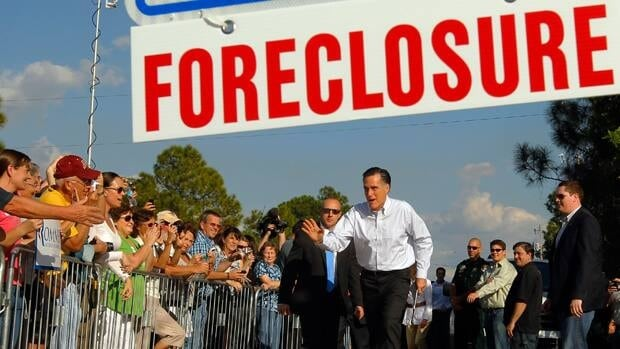 Republican presidential candidate and former Massachusetts governor Mitt Romney arrives for a campaign stop last in front of a foreclosed home in the hard-hit Florida community of Lehigh Acres.