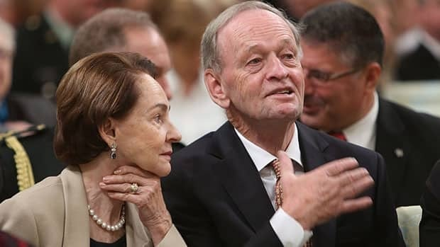 Former prime minister Jean Chretien and his wife Aline await the start of an Order of Canada ceremony at Rideau Hall in Ottawa Friday. Their daughter, France Chretien Desmarais, was among the 44 Canadians to receive the honour.