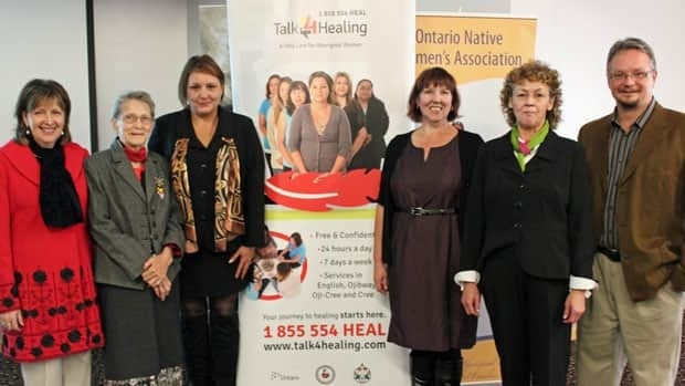 From left, Norrine Carroll, executive assistant to Thunder Bay-Atikokan MPP Bill Mauro; Agnes Hardy, elder; Cindy Cade, ONWA executive assistant; Robin Haliuk, Talk4Healing co-ordinator; Patricia Jurivee, Beendigen executive director; and Jerry Woods, MCSS program director, celebrate the launch of a new service designed to help Aboriginal women in crisis.