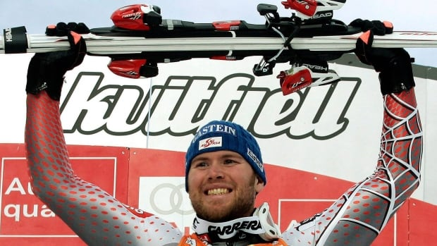 Hans Grugger of Austria celebrating on the podium after winning an Alpine Ski World Cup Men's super-G race.