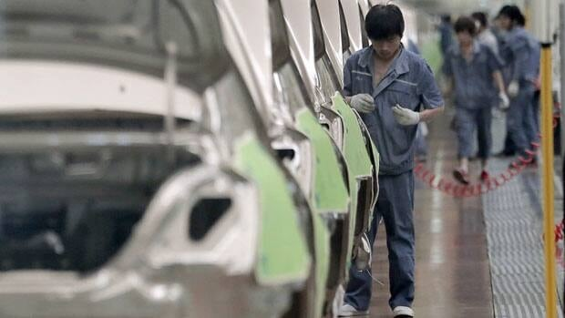 A worker assembles an automobile at Chinese automaker Geely  in Cixi, China, in June. China's manufacturing contracted again in September.