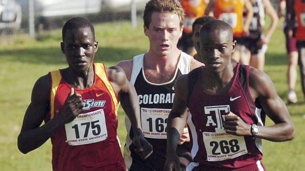 Guor Marial, left, is seen running for Iowa State in 2008. He will race at the London Games under the Olympic flag since his hometown, now part of South Sudan, doesn't have an Olympic team.