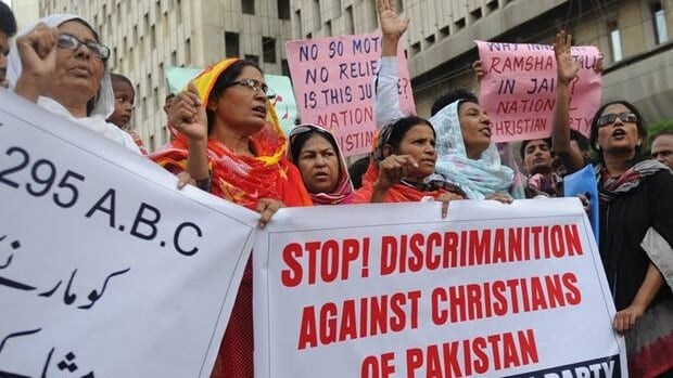 Activists of the National Christian Party shout slogans in the support of a Christian girl accused of burning papers containing verses from the Qur'an, in Karachi on Sept. 4.