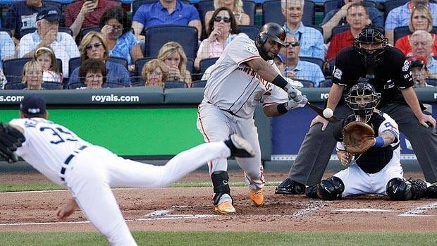 Pablo Sandoval of the San Francisco Giants makes contract for a bases-clearing triple in the first off Detroit ace Justin Verlander. Charlie Neibergall/Associated Press
