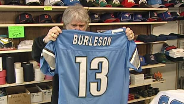 Bob Reaume of Bob Reaume Sports inspects an NFL jersey known to be a fake.