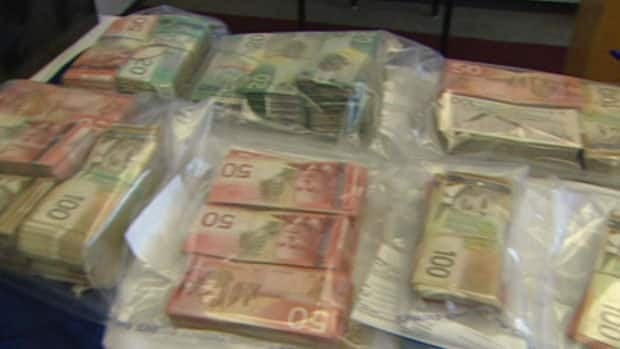 Police found nearly $300,000 in Michael Kavanagh's Torbay home in April 2009.