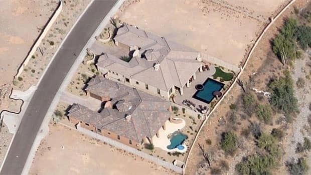 Windgate Ranch, the house at bottom with the wavy-shaped pool, was purchased by Winnipeg Mayor Sam Katz in August. No documents disclosing the price paid are in the public record, but Katz said he paid more than $1 million US.