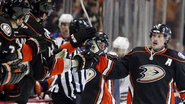 Ducks right-winger Teemu Selanne celebrates with teammates after scoring against Edmonton on Sunday. It was the 41-year-old's 26th goal and 663rd of his career.