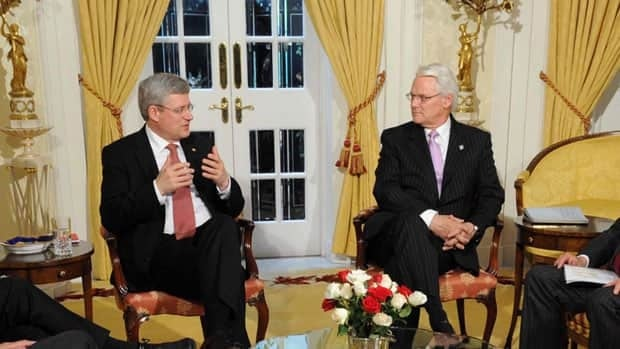 Prime Minister Stephen Harper sits with Gordon Campbell, Canada's high commissioner to the United Kingdom, during a business roundtable in London last month. Campbell has spent more on hospitality expenses than any of his diplomatic counterparts so far this year.