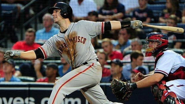 Giants catcher Buster Posey is hitting over .300 this season and on track for 20 home runs and 100 runs batted in.