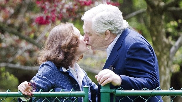 Former media baron Conrad Black kisses his wife, Barbara Amiel Black, upon returning to his Toronto home Friday after serving a 42-month sentence in a Florida prison for fraud and obstruction of justice.