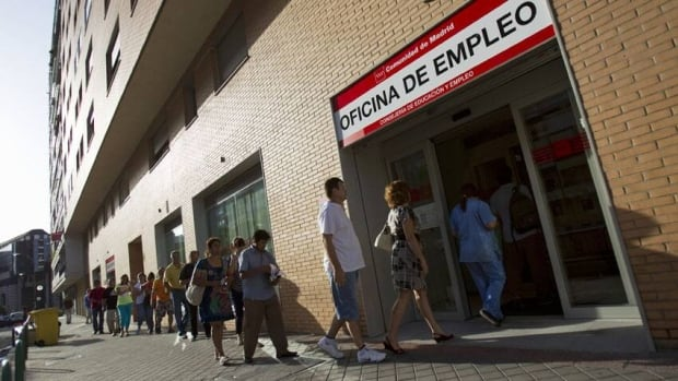 People enter a government-run employment office in Madrid. Spain's 24.6 per cent unemployment rate is the eurozone's highest. More than 17.8 million are out of work in the 17-country eurozone.