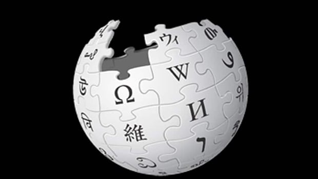 Wikipedia is investigating reports that paid PR writers are putting a promotional spin on things like company profiles.