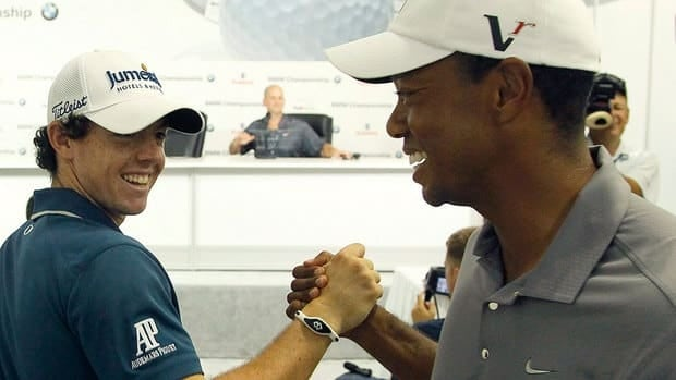 Rory McIlroy, left, and Tiger Woods shake hands between interviews Wednesday at Crooked Stick Golf Club in Carmel, Ind. They will play together in Rounds 1 and 2 at the BMW Championship.