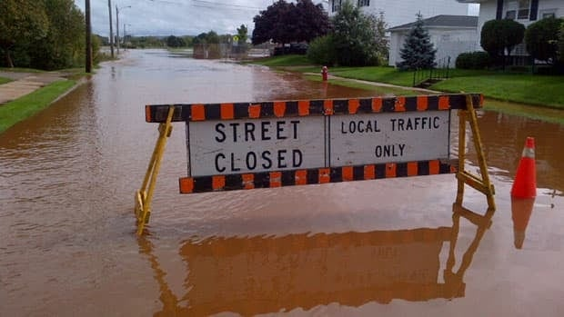 Flooding in Truro has closed some streets and breached dikes are threatening to flood other areas.