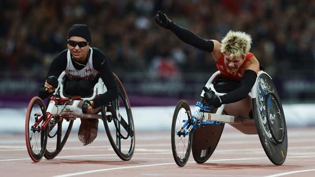 Marieke Vervoort of Belgium celebrates as she wins gold ahead of silver medallist Michelle Stilwell of Canada, left, in the Women's 100m T52 Final on Wednesday.