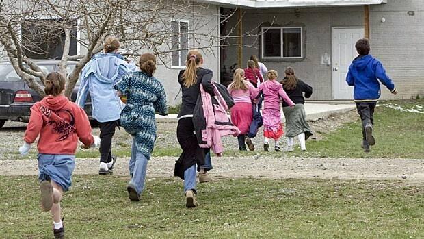Children run back to class following a recess break at Mormon Hills school in the polygamous community of Bountiful near Creston, B.C.
