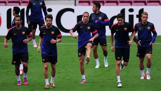 Barcelona players take part in a training session on September 18, 2012 at the Camp Nou stadium in Barcelona.