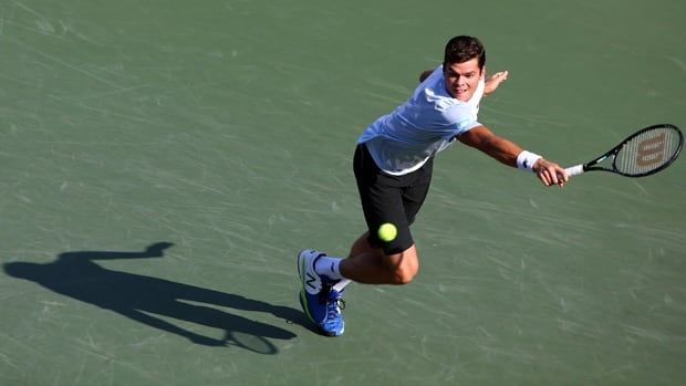 Milos Raonic of Thornhill, Ont., hits a backhand return in a  6-4-, 6-3 triumph at Ariake Colosseum in Tokyo on Thursday.